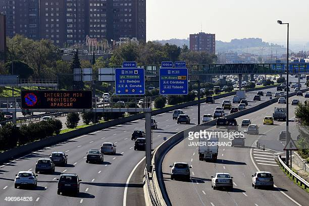 A view taken on November 13 2015 shows vehicles on the M30 speedway with lower speed limits due to a peak of pollution in Madrid Madrid City Council...
