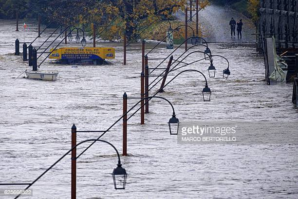 TOPSHOT View taken on November 25 2016 of the overflowed Po river in Turin Torrential downpours caused flooding in parts of northwest Italy with the...