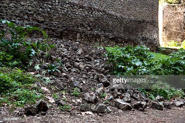 View taken on October 22 2011 shows a collapsed wall in the archaeological site of Pompeii southern Italy Part of an ancient Roman wall has collapsed...