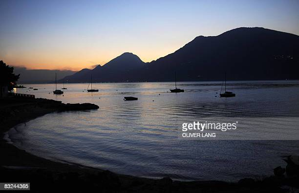 View taken on Oktober 6 2008 shows boats floating on the Lake Garda near Malcesine northern Italy The Garda Lake is the largest Italian lake situated...
