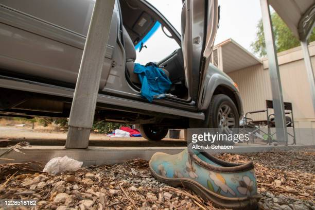 A view the car doors left open and shoes at the property where seven people were shot to death over Labor Day weekend at an illegal marijuana grow...