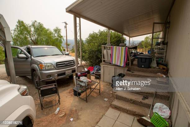 A view the car doors left open at the property where seven people were shot to death over Labor Day weekend at an illegal marijuana grow house in the...