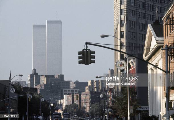 A view the intersection of 6th Avenue Waverly Place in Greenwich Village with the buildings of the Twin Towers of the World Trade Center in the...