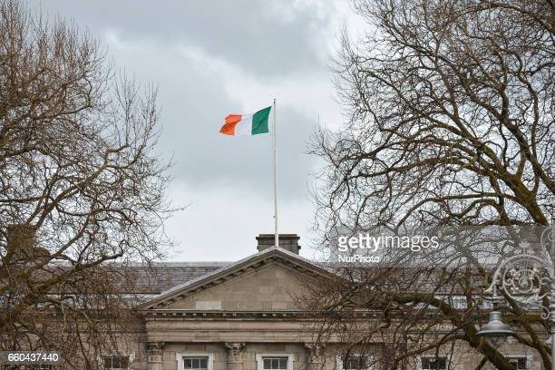A view the Irish tricolor flag on the top of the Leinster House the seat of the Oireachtas the parliament of Ireland On Wednesday March 29 in Dublin...