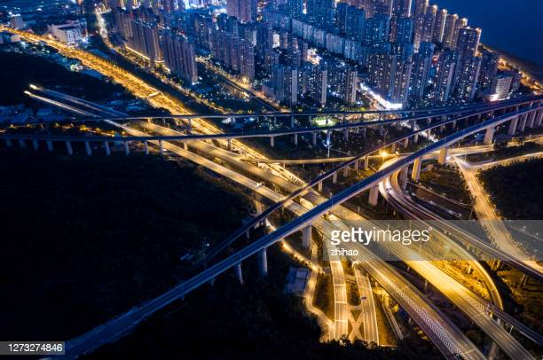 view the night view of the intricate interchange bridges in modern cities from the perspective of drones - fuzhou stock pictures, royalty-free photos & images