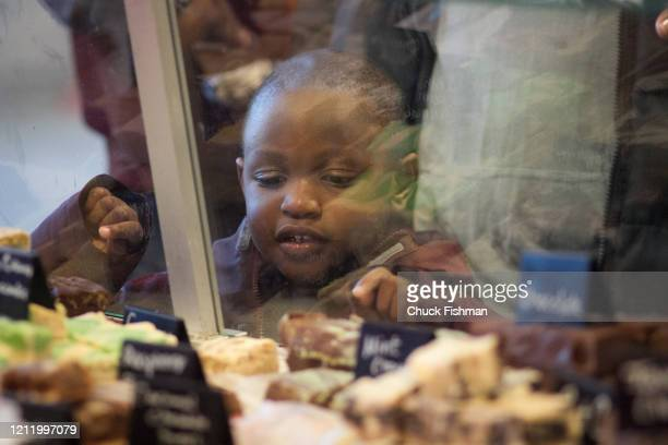 View though a display case as a young boy looks at varieties of fudge on display at the Chocolate Expo held in the Cradle of Aviation Museum Garden...