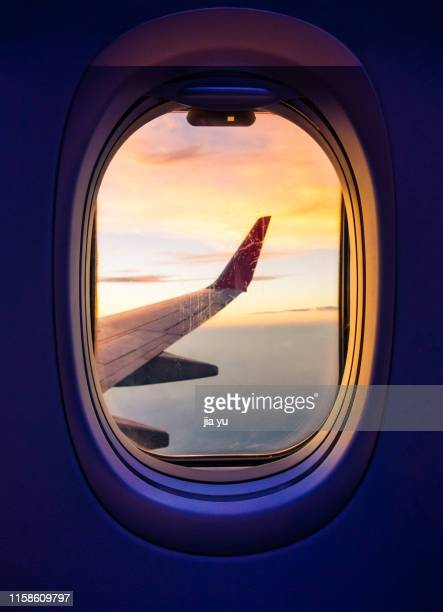 view through a airplane window - aircraft wing stock pictures, royalty-free photos & images