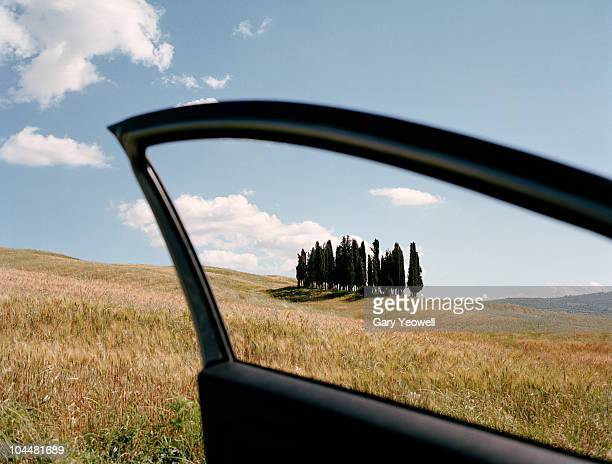 View through a car window to Tuscany landscape