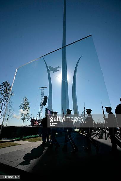 A view through a glass panel of the missing man formation at the opening ceremony of the Air Force Memorial Saturday October 14 opening ceremony...