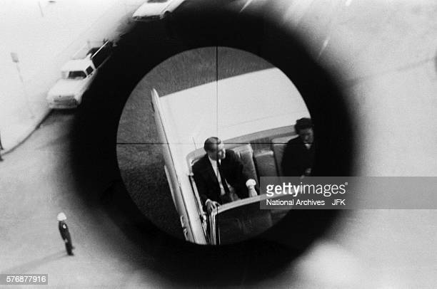 A view through a gun sight from the Texas School Book Depository is part of a reenactment of the Kennedy assassination This evidence was submitted to...