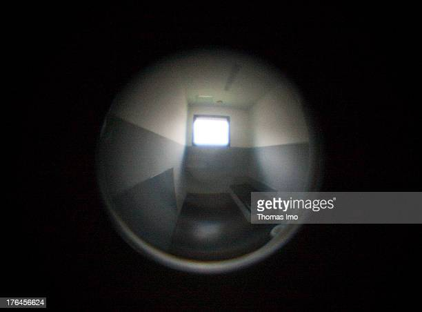View through a peephole into a single cell at the police department of Hagen