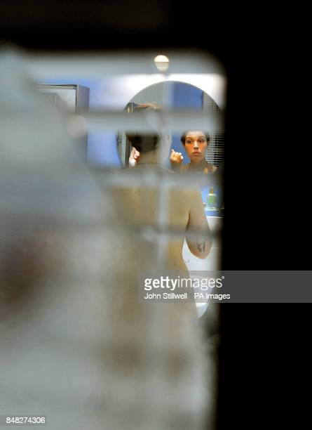A view through a peephole of Diana in the bathroom by British Artist Mark Wallinger that responds to the work of the artist Titian's paintings titled...