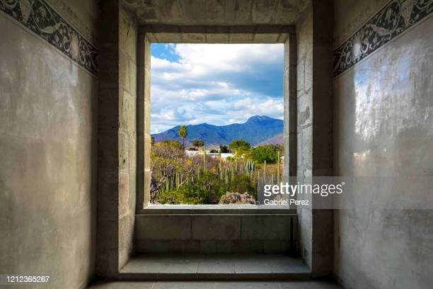 a view through a spanish colonial window - shrine stock pictures, royalty-free photos & images