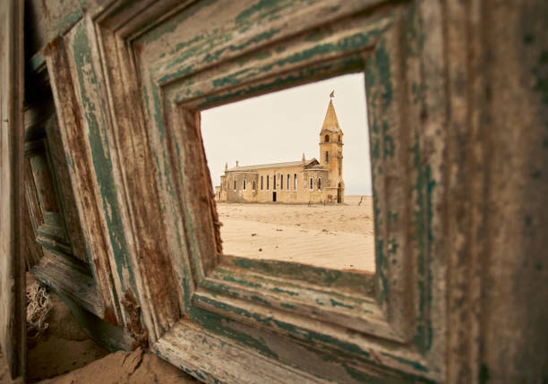 View through a window of the church at the abandoned village of Ilha dos Tigres, Angola.