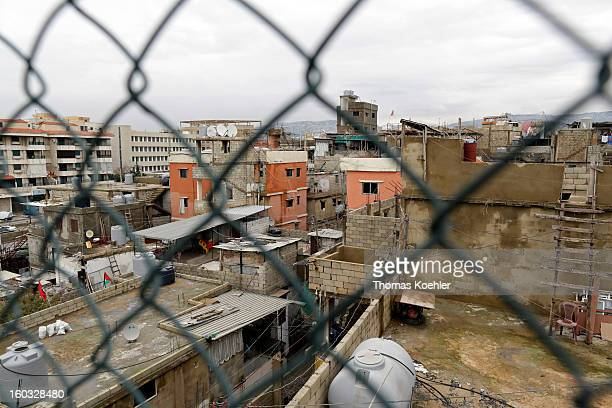 A view through a wire mesh fence across the roof tops of the Palestinian Refugee Camp Burj Barajneh where the living conditions have severely...