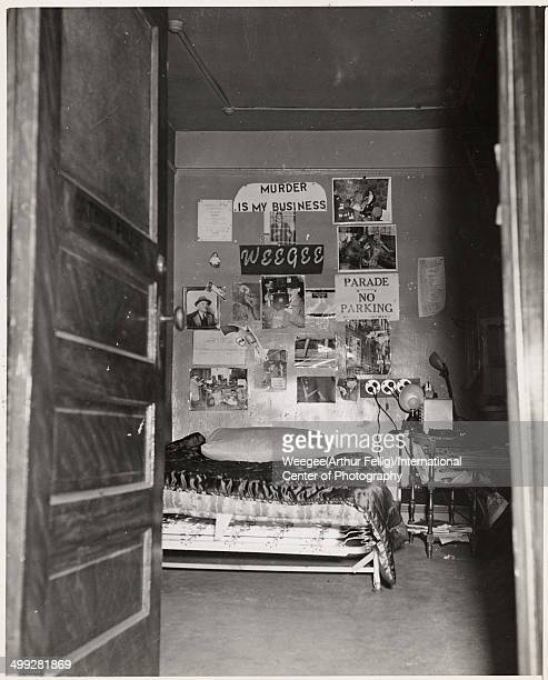 View through an open door into the bedroom of American photographer Arthur Fellig better known as Weegee in a photograph entitled 'My headquarters'...