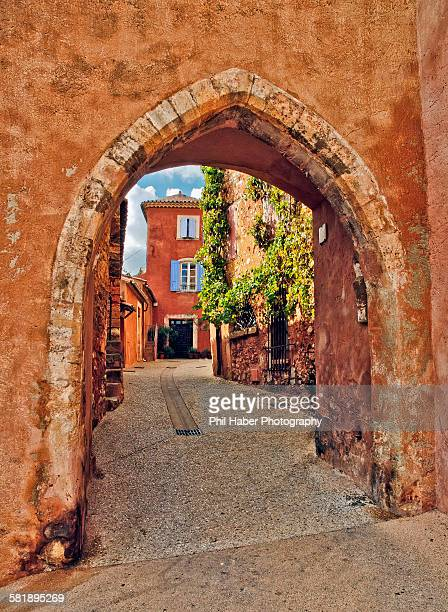 view through arch, roussillon - phil haber stock pictures, royalty-free photos & images