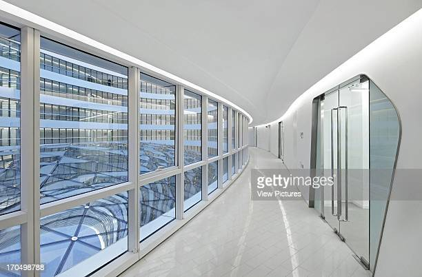 View through empty glazed corridor Galaxy Soho Beijing China Architect Zaha Hadid Architects 2012