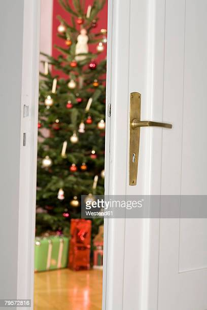 View through open door to Christmas tree and presents