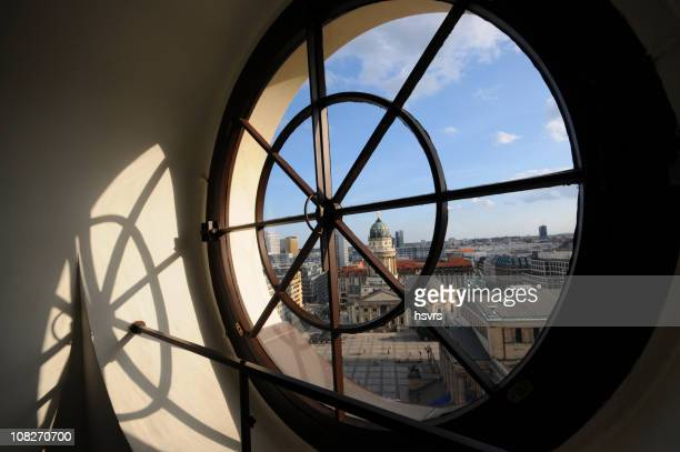 view through porthole to german cathedral at gendarmenmarkt (berlin) - gendarmenmarkt stock photos and pictures