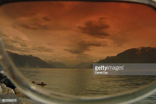 view through rose tinted glasses, lac leman, switzerland - lac rose photos et images de collection