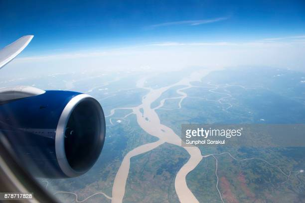 View Through The Airplane Window with river delta landscape