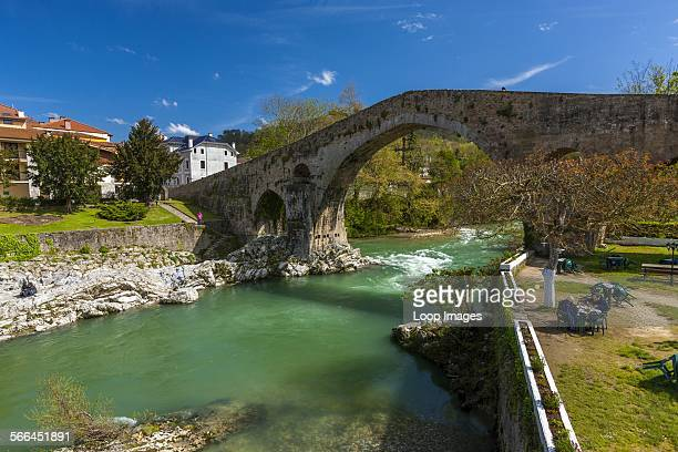 A view through the archway of a Roman bridge over the Sella River in Cangas De Onis