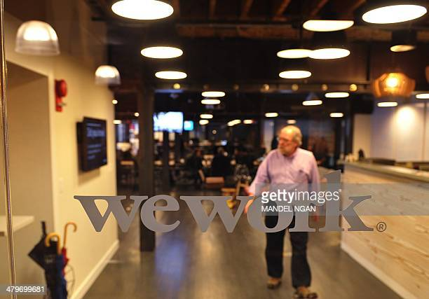 A view through the front door of the WeWork cooperative coworking space on March 13 2013 in Washington DC In a large warehousetype office in...