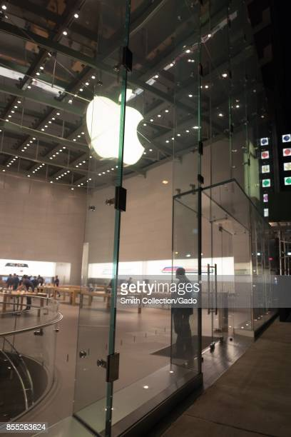 View through the front window of the Apple Upper West Side store one of the flagship apple stores in Manhattan New York City New York at night...