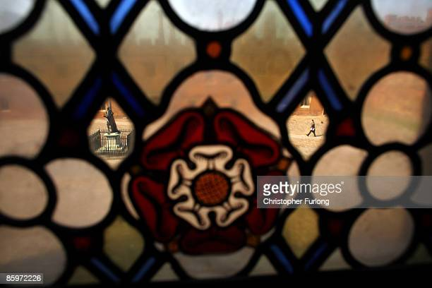 A view through the stained glass windows of College Chapel as boys make their way to classes across the historic School Yard of Eton school on May 21...