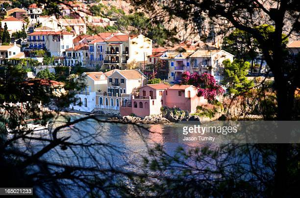 CONTENT] A view through the tree of the small old fashioned Greek village of Assos in Kefalonia in 2012 Small pretty houses on a hillside overlooking...