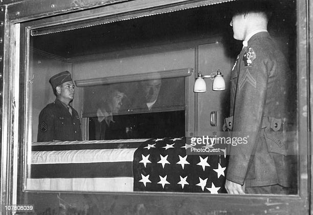 View through the window of a train car that carries former American President Franklin Delano Roosevelt's coffin towaards its burial sits April 14...
