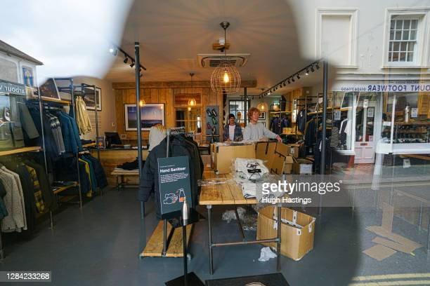 View through the window of the Falmouth branch of Finisterre clothing closed by the Covid-19 lockdown on November 6, 2020 in Falmouth, England....