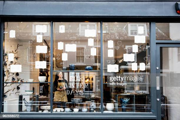 view through window into a pottery shop. - store stock pictures, royalty-free photos & images