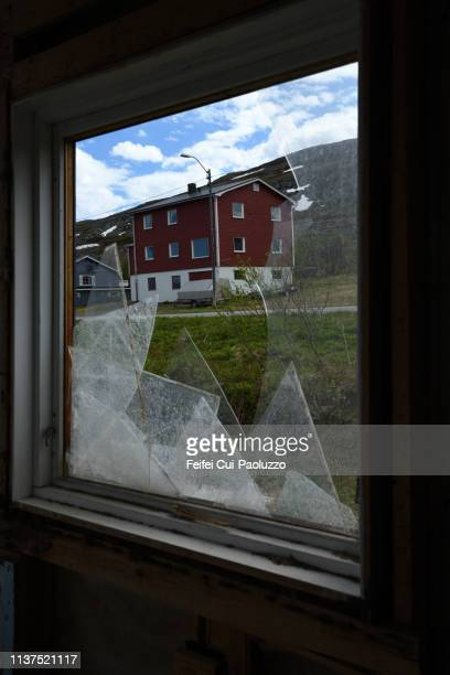 view through window of an abandoned house at båtsfjord, northern norway - feifei cui paoluzzo stock pictures, royalty-free photos & images