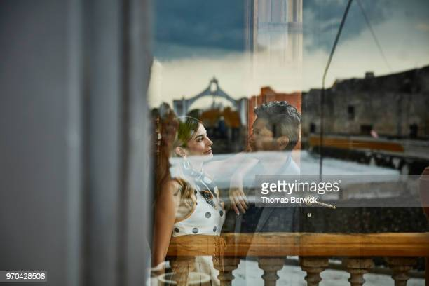 View through window of couple embracing