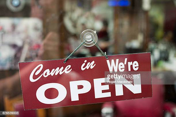 view through window of open sign in shop - open for business stock pictures, royalty-free photos & images