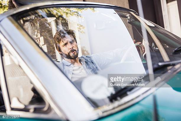 View through windscreen of man in car
