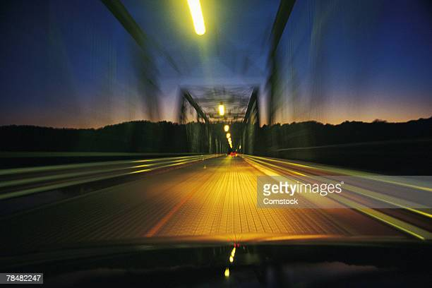 View through windshield crossing over a bridge