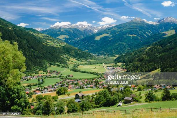 a view to an alpine town of lienze, austria in summer season. - austria stock pictures, royalty-free photos & images