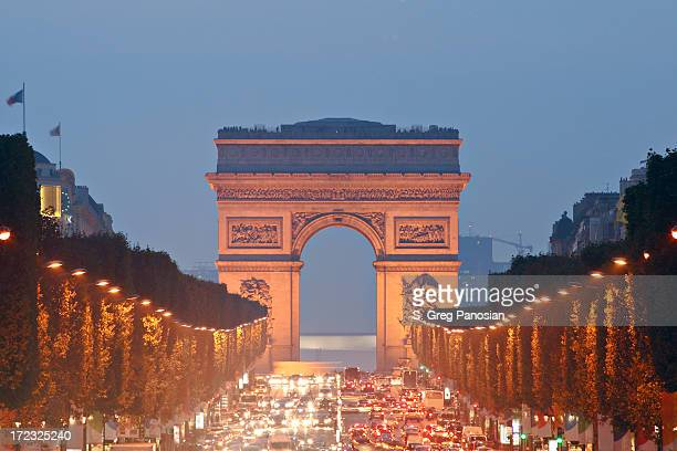 View to Arc de Triomphe over traffic on Champs Elysee, Paris
