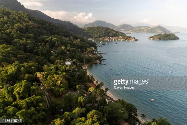 view to atlantic rainforest islands and beach on the ocean landscape - angra dos reis imagens e fotografias de stock