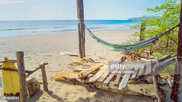 view to beach from rustic spot at playa naranjo, santa rosa national park, guanacaste, costa rica - parque nacional de santa rosa fotografías e imágenes de stock