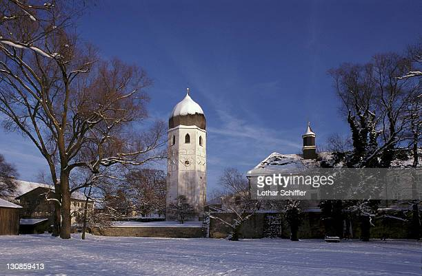 View to Frauenchiemsee monastery on snow covered Fraueninsel in lake Chiemsee; Bayaria, Germany