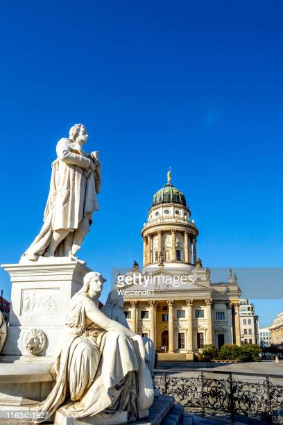view to french cathedral with schiller monument in the foreground, gendarmenmarkt, berlin, germany - französischer dom stock pictures, royalty-free photos & images