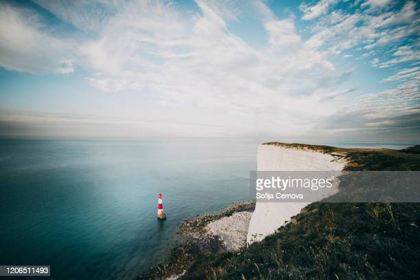 view to lighthouse from white cliff - cloud sky stock pictures, royalty-free photos & images