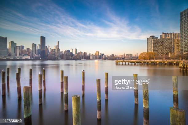 view to manhattan skyline from the long island city - queens new york city stock pictures, royalty-free photos & images