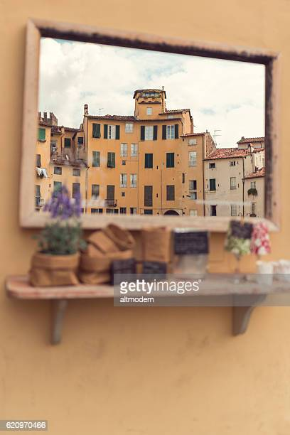 view to Piazza Anfiteatro lucca through a mirror