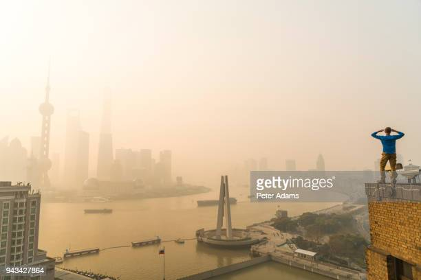 view to pudong financial skyline across huangpu river, shanghai,china - peter adams stock pictures, royalty-free photos & images