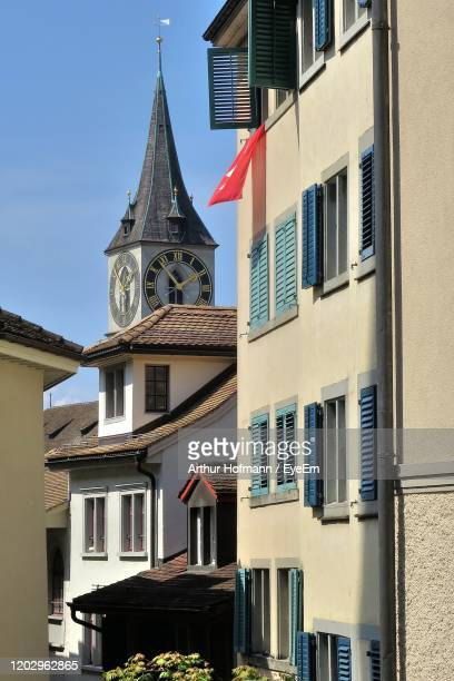 view to st.peter kirche in zürich - kirche stock pictures, royalty-free photos & images